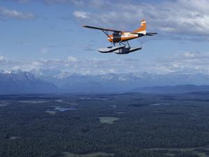 A Cessna Plane Flies over Backcountry Air Lanes Near the Alaska Range by Ira Block