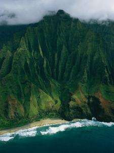 Aerial View of a Beach at the Base of a Lush South Pacific Mountain by Ira Block