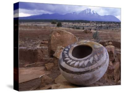 An Ancient Pottery Seed Jar, with Sleeping Ute Mountain in the Distance