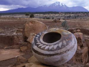An Ancient Pottery Seed Jar, with Sleeping Ute Mountain in the Distance by Ira Block