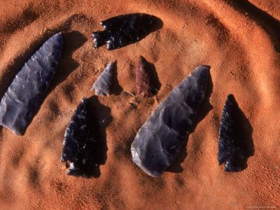 Ancient Anasazi Arrowheads in Sand by Ira Block