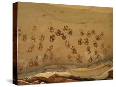 Ancient Indian Handprints Decorate a Sandstone Wall