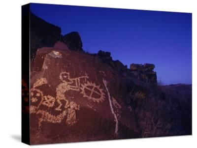 Ancient Rock Art Showing Kokopelli, the Flute Player, and a Shield