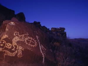 Ancient Rock Art Showing Kokopelli, the Flute Player, and a Shield by Ira Block