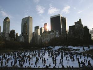 Elevated View of Ice Skaters in Central Park and of the Surrounding Cityscape by Ira Block