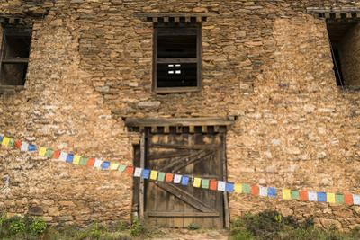 Prayer Flags in Front of the Drukgyal Dzong in Paro Bhutan by Ira Block