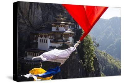Prayer Flags Sway in the Wind Near Taktsang Monastery