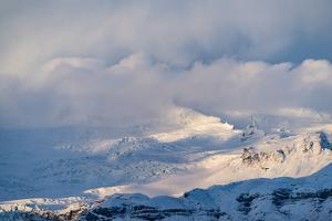 Snowcapped Mountains in Southern Iceland by Ira Block