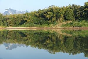 The Calm Mekong River around Pak Ou in Laos by Ira Block