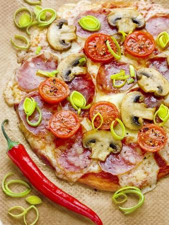 Pizza with Salami, Mushrooms, Tomatoes, Leek, Mozzarella and Chillis