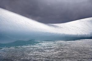 A Smooth Iceberg in Moving Water under Cloudy Skies by Ira Meyer
