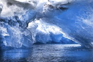 An Iceberg Arch Through Intensely Blue Icebergs by Ira Meyer