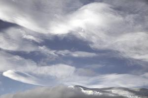 Billowing, Wind-Blown Clouds over Glaciated Mountains by Ira Meyer