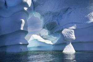 Blue Icebergs Including an Arch, Sculpted by Waves and Melting by Ira Meyer