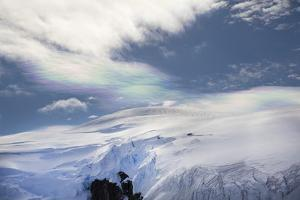 Colorful Prismatic Clouds over Glaciated Mountains by Ira Meyer