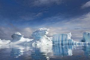 Cumulus Clouds over Blue Icebergs Reflected in Water by Ira Meyer