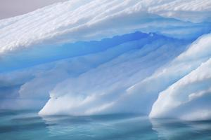 Detail of a Blue Iceberg in Calm Blue Water by Ira Meyer