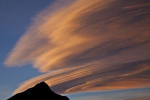 Lenticular Clouds over a Peak at Sunset by Ira Meyer