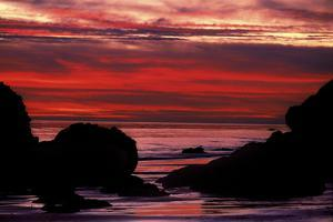 Silhouetted Rock Formations During a Dramatic Fiery Sunset at El Matador Beach by Ira Meyer