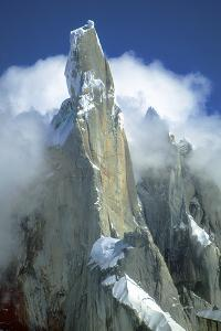 The Snow-Dusted Peak of Cerro Torre Amid the Clouds by Ira Meyer
