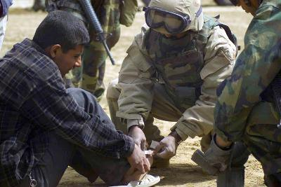 Iraqi Detainee Receives a Bandage While under Interrogation, March 24, 2003--Photo