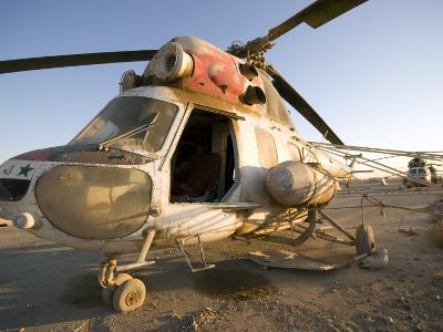 Iraqi Helicopter Sits on the Flight Deck Abandoned at Camp Warhorse-Stocktrek Images-Photographic Print