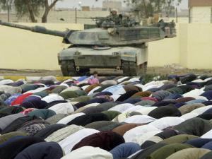 Iraqi Shiite Muslims Pray on the First Day of Eid Al-Fitr