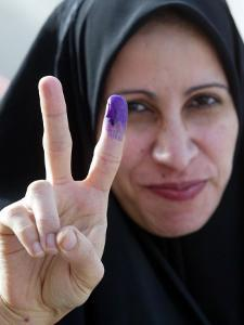 Iraqi Woman Holds Up Her Purple Finger, Indicating She Has Just Voted in Southern Iraq
