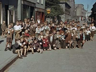 Irish School Children Eat Sweets on the Street During Recess-Howell Walker-Photographic Print