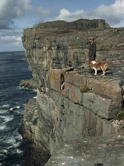 Irishman with His Dog Admire the View of the Ocean from a Cliff-Howell Walker-Photographic Print
