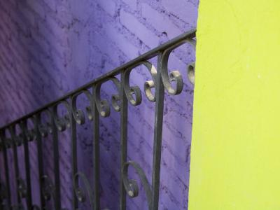 Iron Railing Against Colorful Walls, San Miguel, Guanajuato State, Mexico-Julie Eggers-Photographic Print