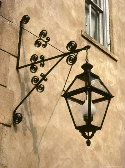 Iron Street Lamp Hangs From a Historic Building-Rex Stucky-Photographic Print