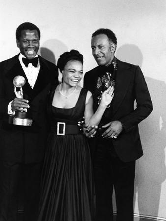 Actress Eartha Kitt poses with Sidney Portier and Raymond St. Jacques at the NACCP Awards Banquet i