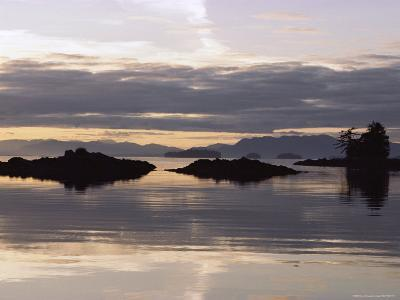 Islands and Clouds Reflect on a Calm Sea at Kah Shakes Cove-Bill Curtsinger-Photographic Print