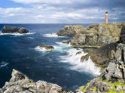 https://imgc.artprintimages.com/img/print/isle-of-lewis-coast-and-lighthouse-at-the-butt-of-lewis-scotland_u-l-pyp8mz0.jpg?artPerspective=n