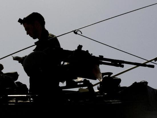 Israeli Soldier Prays on Top of a Tank Just Outside the Southern Gaza Strip--Photographic Print