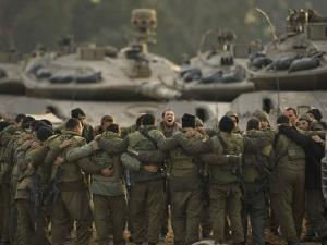 Israeli Soldiers Chant Slogans after a Briefing before Entering Gaza on a Combat Mission