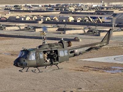Italian Army AB-205MEP Utility Helicopter in Flight over Shindand, Afghanistan-Stocktrek Images-Photographic Print