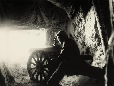 Italian Soldier in a Snow Cave on Monte Nero During World War I--Photographic Print