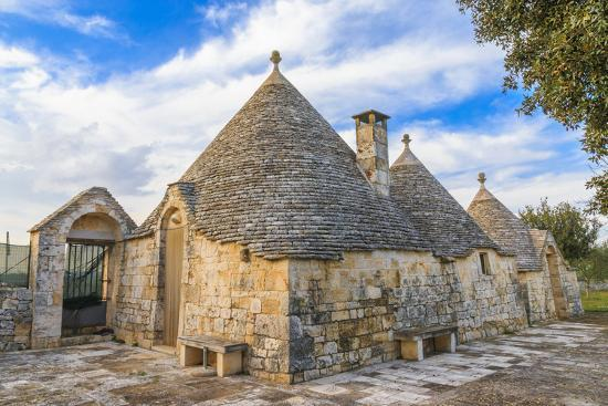 Italy, Region of Apulia, Province of Bari, Itria Valley, Alberobello. A trullo house-Emily Wilson-Photographic Print