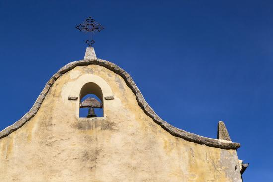 Italy, Sardinia, Gavoi. the Bell and Cross of an Old Church, Backed by a Blue Sky-Alida Latham-Photographic Print