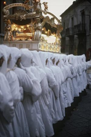 https://imgc.artprintimages.com/img/print/italy-sicily-region-enna-holy-week-celebration-good-friday-procession_u-l-pou2740.jpg?p=0