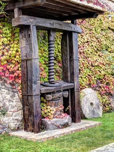 Italy, Tuscany. an Olive Oil Press on Display at a Winery in Tuscany-Julie Eggers-Photographic Print