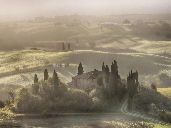 Italy, Tuscany, light filters through the fog at Belvedere House-Terry Eggers-Photographic Print