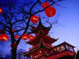 Chinese Pagoda and Tree Lanterns in Tivoli Park, Copenhagen, Denmark by Izzet Keribar