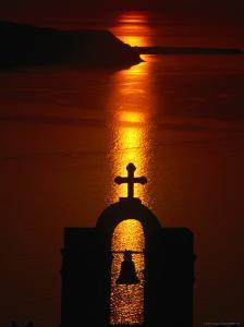 Church Belltower Silhouetted at Sunset, Greece by Izzet Keribar