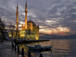 Ortakoy Mosque Looking Towards the Bosphorus Bridge, under a Cloudy Sky by Izzet Keribar