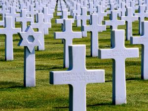 Star of David and Crucifixes in American Cemetery, Omaha Beach, France by Izzet Keribar