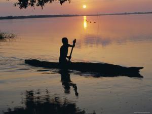Anouak Man in Canoe, Lake Tata, Ethiopia, Africa by J P De Manne