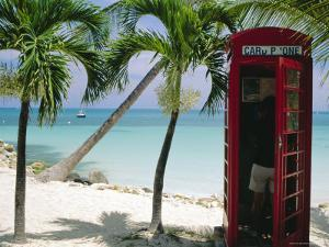 English Telephone Box on the Beach, Dickenson's Bay, North-East Coast, Antigua, West Indies by J P De Manne